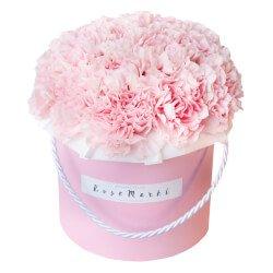 Розовые гвоздики вшляпной коробке в Санкт-Петербурге